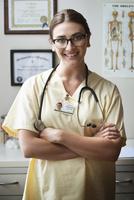 Caucasian nurse smiling in clinic