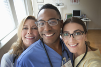 Doctor and nurses smiling in clinic