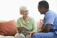 Nurse and patient using digital tablet