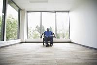 Black businessman sitting in empty office