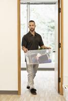 Caucasian businessman carrying personal items