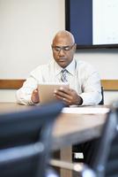 Black businessman using digital tablet in office