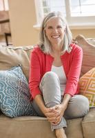Caucasian woman sitting on sofa