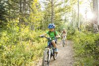 Caucasian children riding mountain bikes
