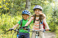 Caucasian children riding mountain bikes