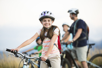 Caucasian girl smiling on mountain bike