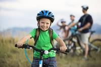 Caucasian boy smiling on mountain bike