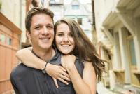 Caucasian couple hugging in village