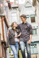 Caucasian couple walking in village