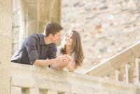 Caucasian couple leaning on balcony