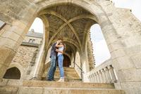 Caucasian couple standing on castle steps