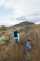 Caucasian children exploring hillside