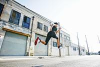 Mixed race woman running outdoors