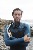 Hispanic diver wearing snorkel mask