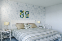 Bed and wall art in modern bedroom