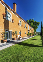 Traditional hotel and grass walkway