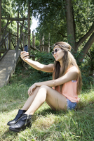 Asian woman taking selfie outdoors