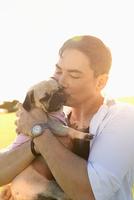 Korean man kissing dog