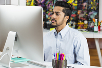 Middle Eastern businessman working in office