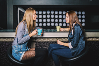Women talking in coffee shop