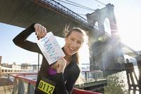 Caucasian runner holding race sign, New York, New York, United States
