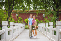 Caucasian couple smiling on bridge