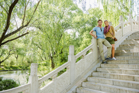 Caucasian couple standing on bridge
