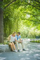 Caucasian couple reading map in park