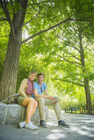 Caucasian couple smiling in park