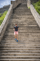 Caucasian man jogging on Great Wall of China, Beijing, Hebei Province, China