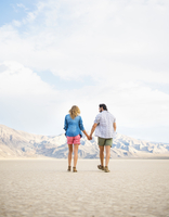 Hispanic couple walking in remote desert