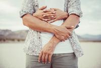 Hispanic couple hugging in remote desert