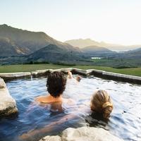 Hispanic couple admiring scenic view in pool