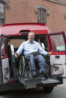 Caucasian man in wheelchair in accessible van