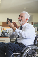 Caucasian businessman using digital tablet in office