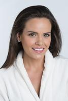 Hispanic woman smiling in bathrobe