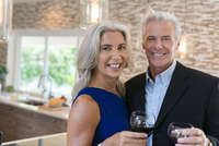 Caucasian couple drinking wine in kitchen