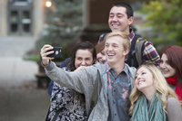 College students taking selfie on campus