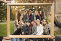 College students posing in frame on campus