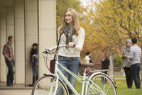 College student with bicycle on campus
