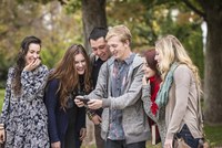 College students using cell phone on campus