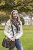 Caucasian college student smiling on campus