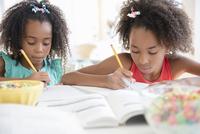 Mixed race sisters doing homework