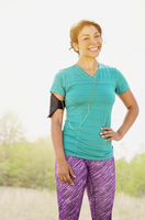Mixed race runner smiling outdoors