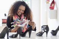 Black woman admiring shoes in store