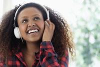 Black woman listening to headphones