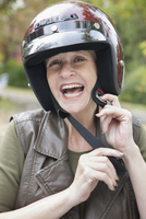 Woman fastening motorcycle helmet