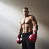 Hispanic boxer wearing boxing gloves