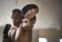 Hispanic boxer punching