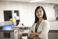 Asian businesswoman smiling in office